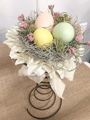 rusty spring nest with eggs