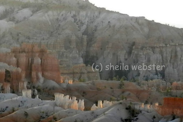a close-up of white hoodoos in the distance
