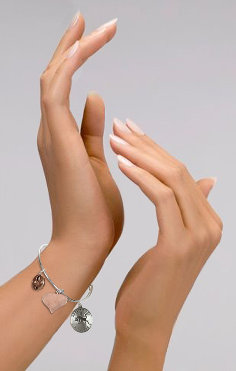 hands showing off M Ference & Co. Zodiac Bangle Charm Bracelet