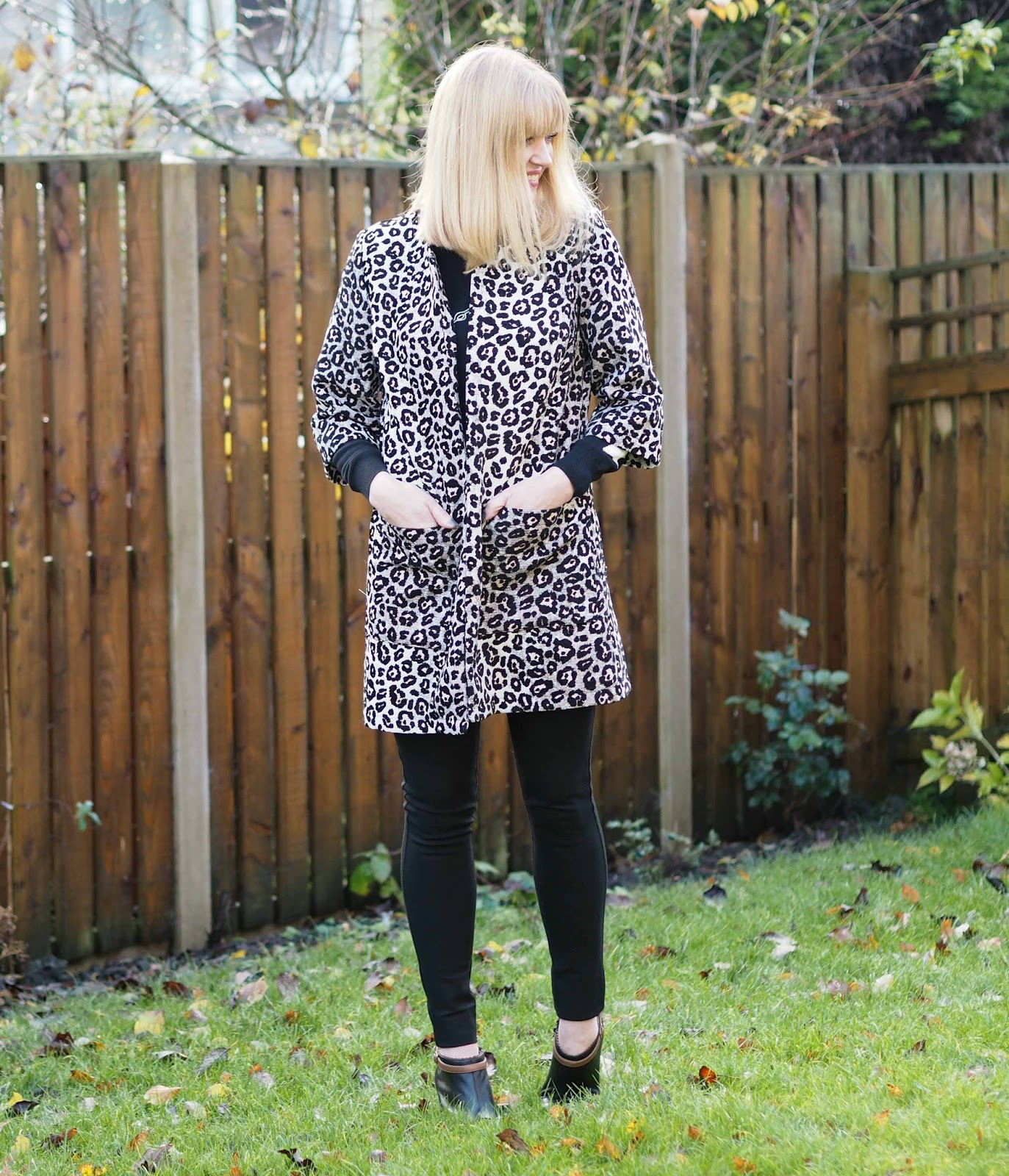Kaleidoscope leopard print jacket, black slim trousers and ankle boots, over 40