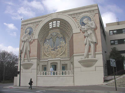 Building exterior with ancient Greek wall mural enhancing