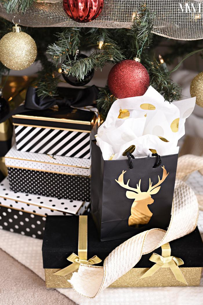 Gift boxes and bags under a Christmas tree