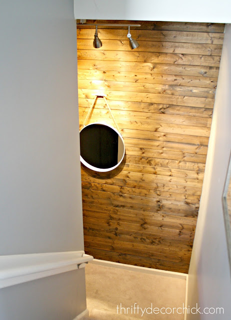 Planked wood wall on stairs