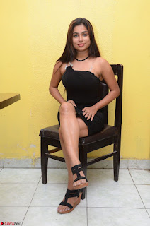 Vrushali Gosavi in strapless Short Black Dress At Follow Follow U Audio Launch 013.JPG