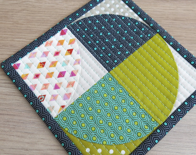 Luna Lovequilts - Quilted coaster - Hand applique quarter circle using freezer paper
