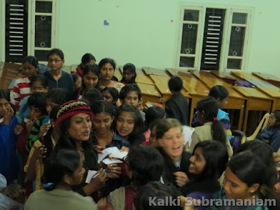 Children at Montfort International School getting autographs from Kalki Subramaniam