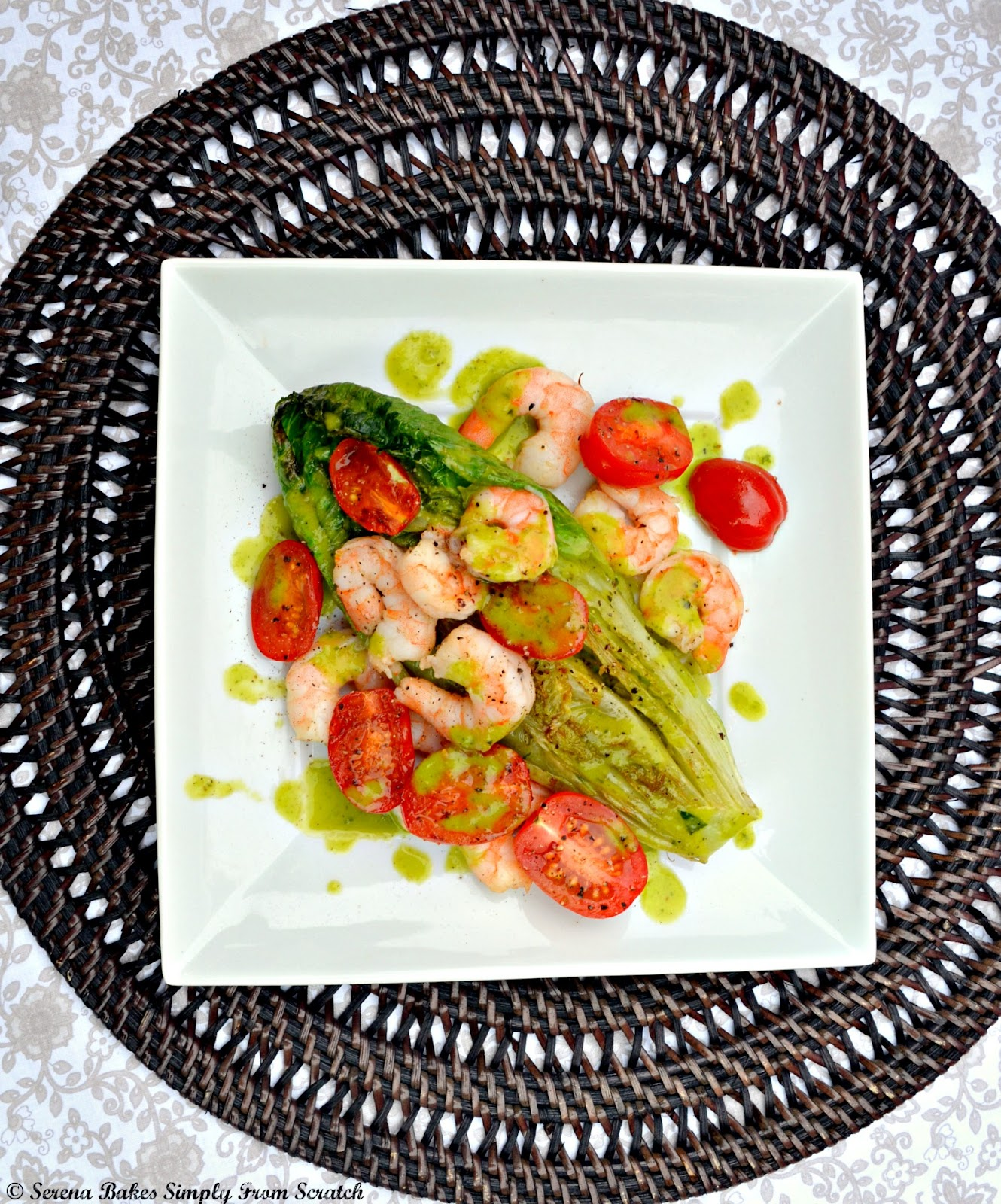 Grilled Romaine Salad with shrimp and a basil vinaigrette made with romaine hearts is a delicious main dish or side warm salad recipe from Serena Bakes Simply From Scratch.