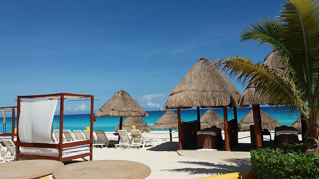 a view of gazebo and sea the Cancun beaches