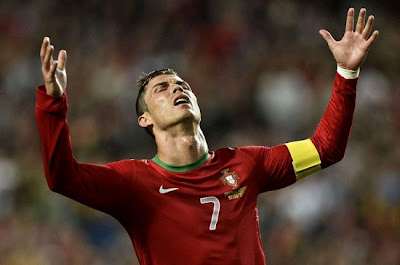 Portugal's forward Cristiano Ronaldo reacts during the World Cup 2014 qualifier football match Portugal vs Russia at Luz Stadium in Lisbon on June 7, 2013