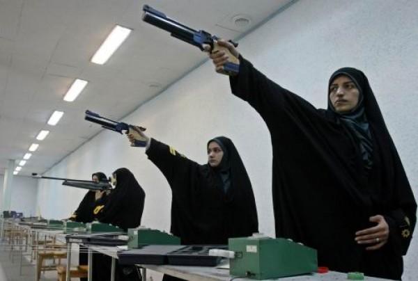 [Image: tameside-muslim-woman-olympic-gun-practice-.jpg]