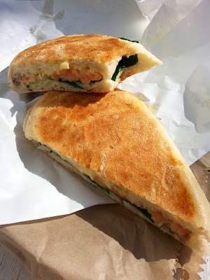 Toasted panini with salmon, brie and spinach.