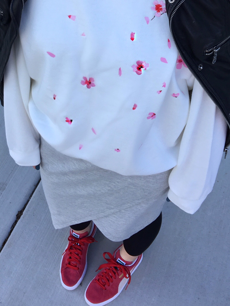 White sweatshirt with a small floral pattern