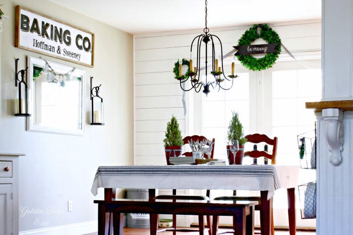 Plank wall dining room with DIY Baking Co. sign and boxwood wreaths - www.goldenboysandme.com