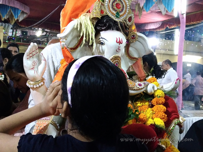 A little girl whispers into Bappa's ears - Ananth Chaturdashi, Ganesh Visarjan, Mumbai
