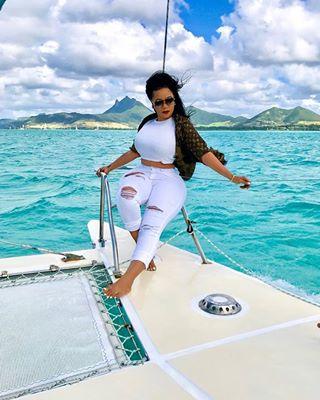 Vera Sidika on a boat, Beach
