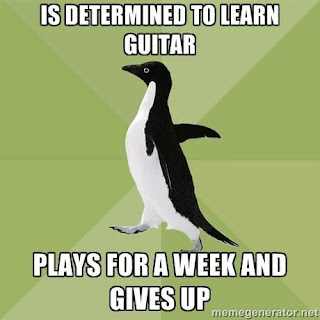 Is determined to learn guitar plays for a week and gives up