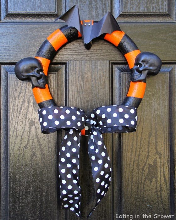 Spray Painted Styrofoam Orange and Black Striped Halloween Wreath With Skeletons and Bats