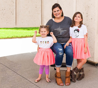 mother and two young daughters model shirts from the UGauGrrl line
