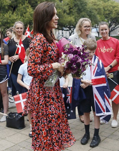 Crown Princess Mary wore a floral-petal printed dress by Giambattista Valli, and Prada pumps, carried Naledi Copenhagen clutch
