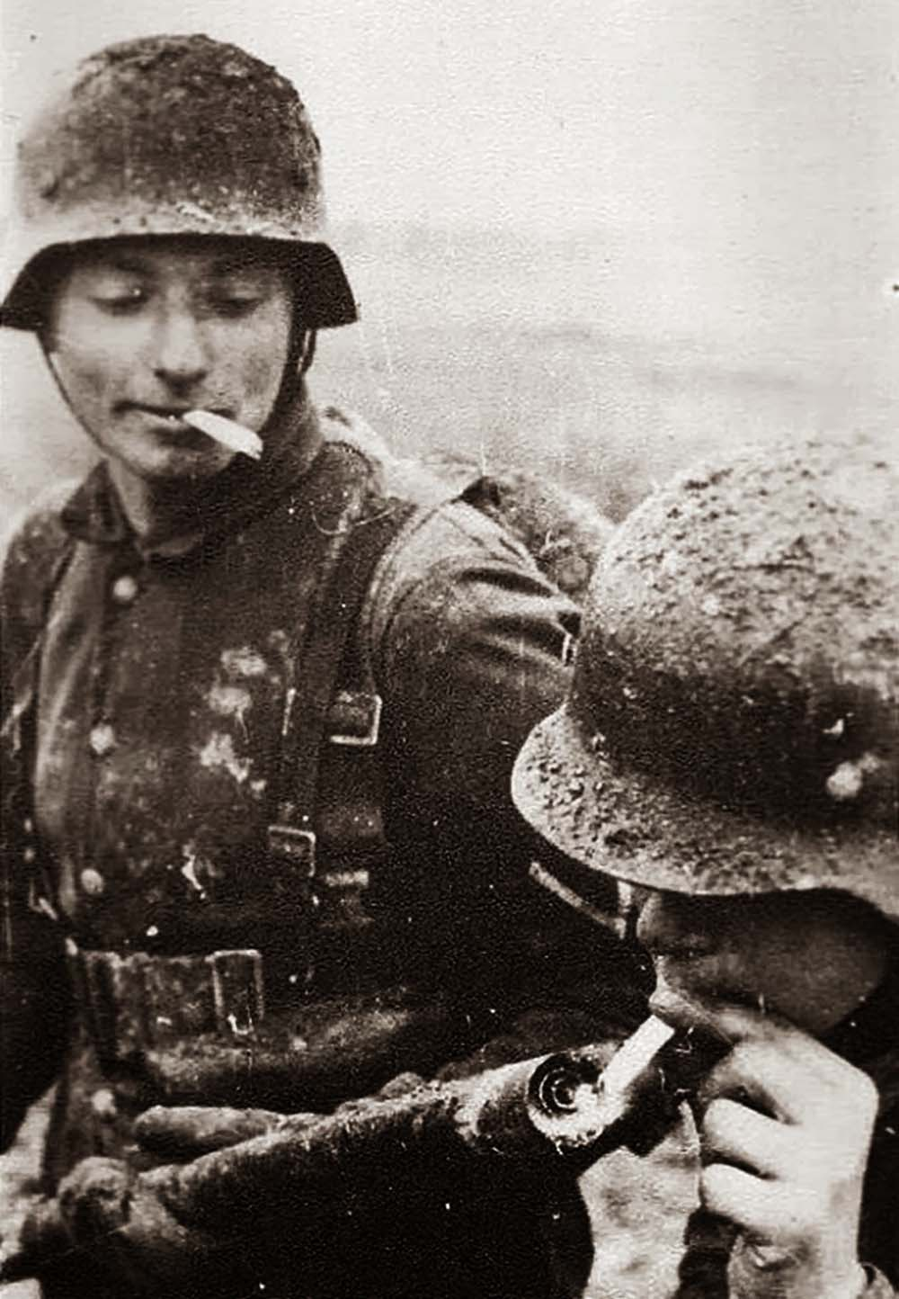 German soldier lighting his cigarette with a flamethrower, 1917.