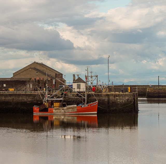 Photo of a brightly coloured fishing boat in Maryport Harbour
