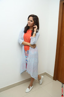 Actress Anasuya Bharadwaj in Orange Short Dress Glam Pics at Winner Movie Press Meet February 2017 (105).JPG