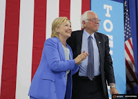 Hillary Clinton and Bernie Sanders hammered out their differences on a carbon tax to arrive at a Democratic Party platform both could agree with. (Credit: Reuters) Click to Enlarge.