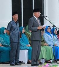 Plt Bupati Asahan Surya membacakan pidato menteri.