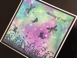 Hand made thinking of you card with distress oxide ink background and stamped fairies and dragonflies