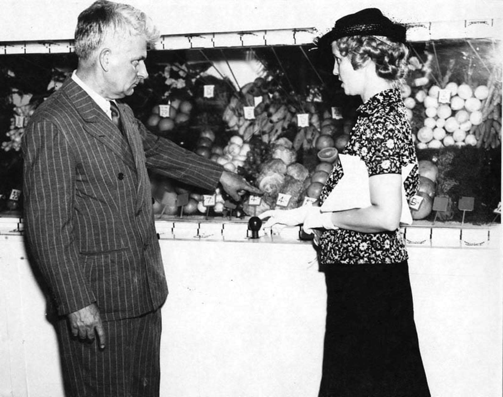 Saunders shows a customer how to select produce. The historian Freeman writes,
