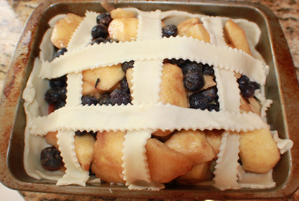 this is a homemade pie with blueberries and apples