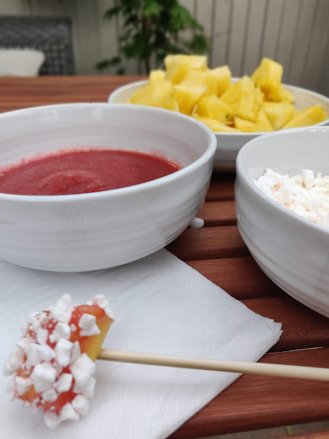 Pineapple with strawberry and vanilla coulis and meringue dessert  for BBQ