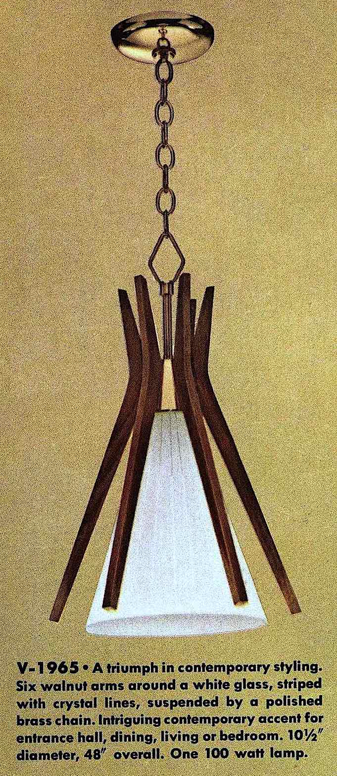 a colr photograph of a 1963 lighting fixture, glass with walnut arms in a pinched design