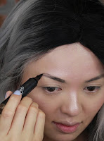 Create the shape of your eyebrow with this 3CE Longwear Tattoo Eyebrow Marker #Ash Brown, then filling in the sparse areas of the brow