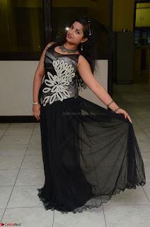 Shrisha Dasari in Sleeveless Short Black Dress At Follow Follow U Audio Launch 017.JPG