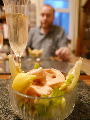 A dish of prawn cocktail and a glass of champagne