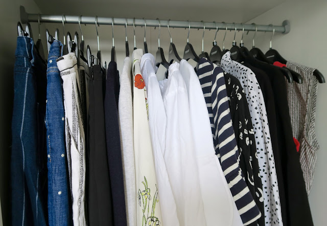 Shopping for clothes by Laura Lewis