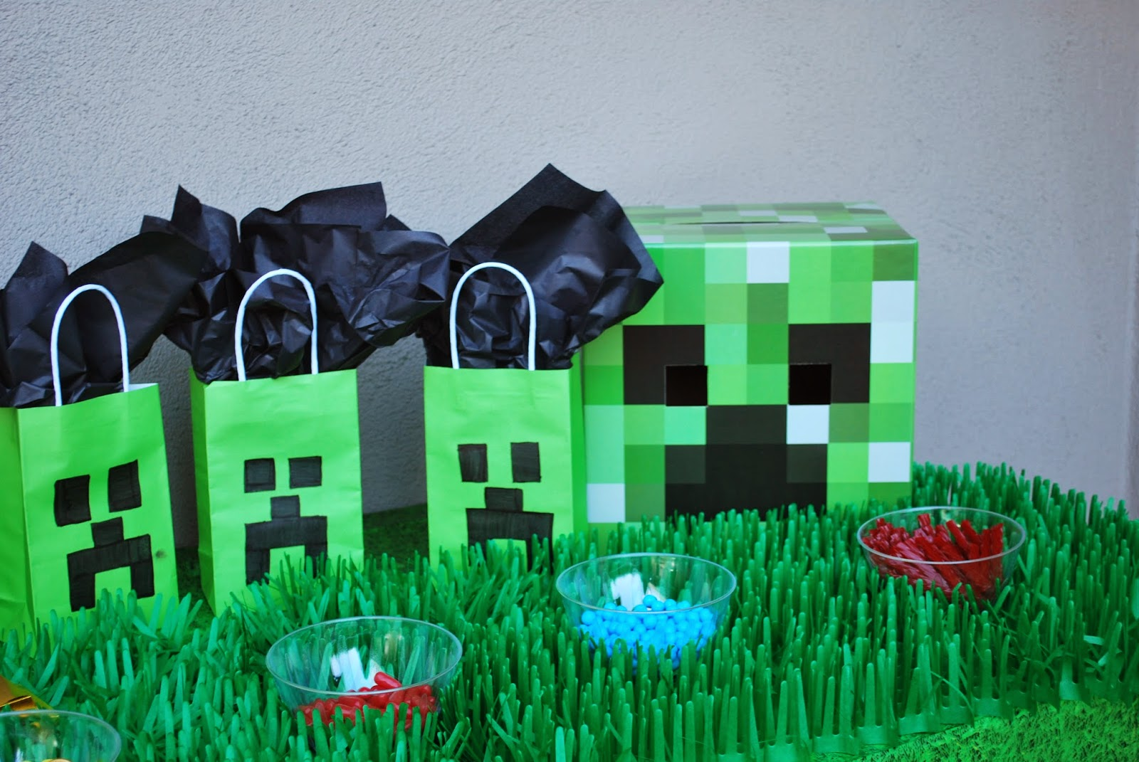 A Minecraft Birthday Party With Cake And Goodie Bags