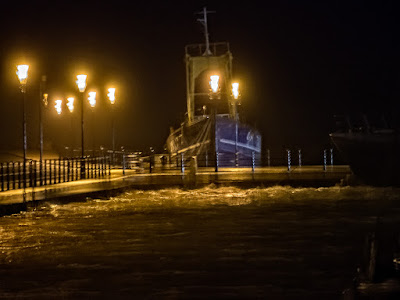 Photo of the trawler outside the marina seen from inside at high tide