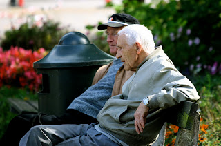 two old men sitting on a park bench picture