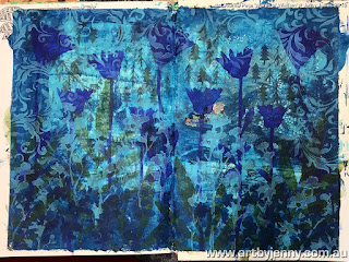 an art journal page by jenny featuring blue acrylic paints and beautiful stencils