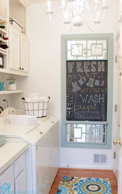 laundry room makeover - small space decorated in white and aqua