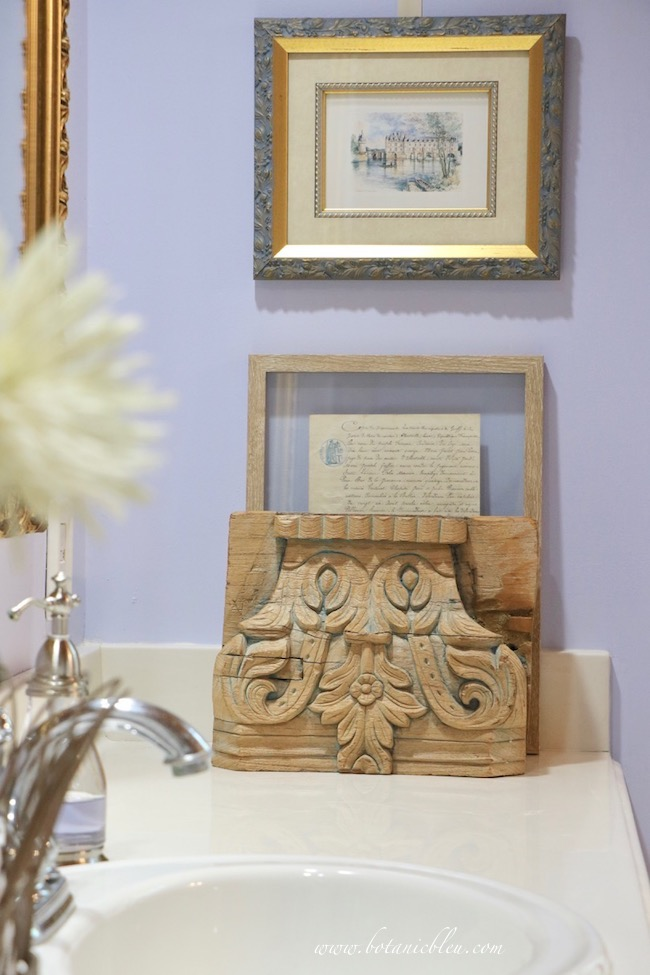 architectural salvaged wood carving in new master bathroom