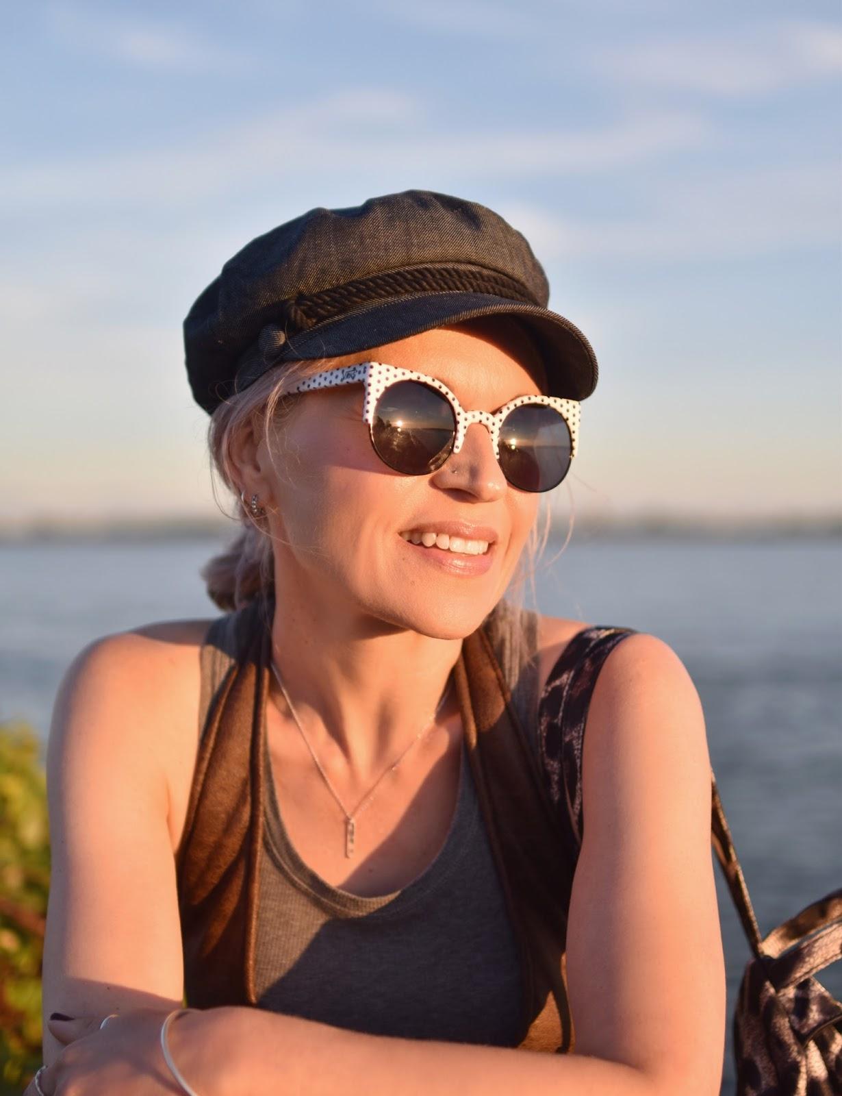 Monika Faulkner outfit inspiration - baker boy cap, Vans polka-dot sunglasses