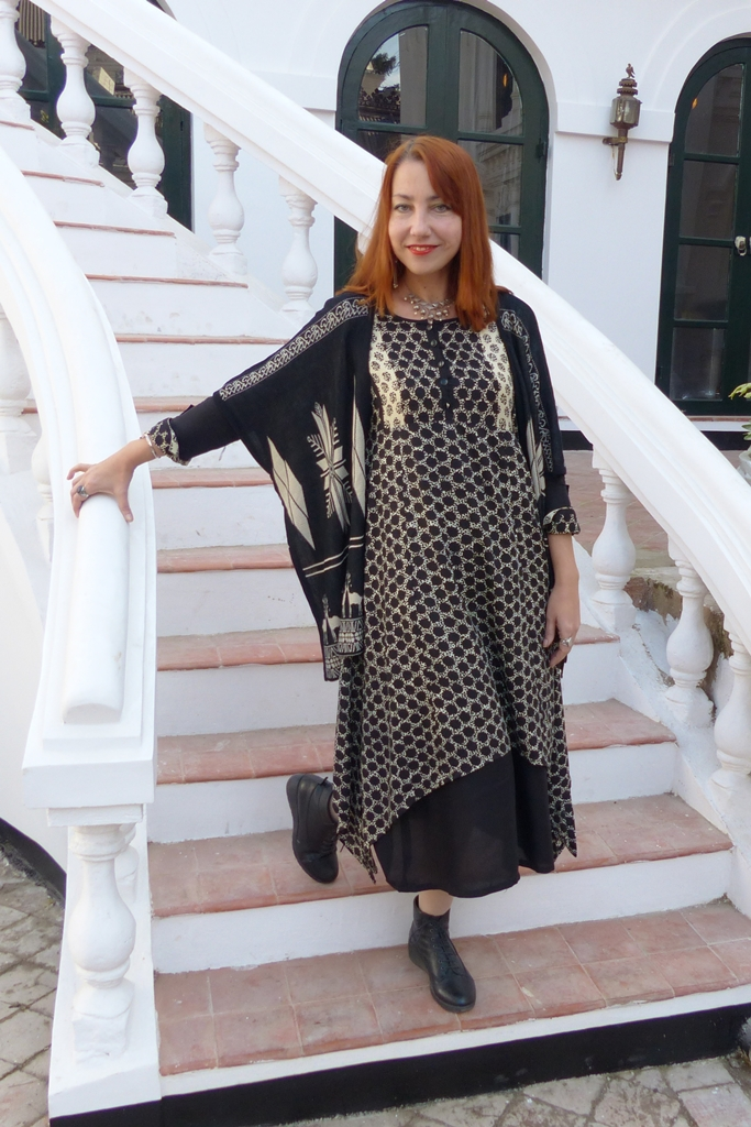 Long dress worn with poncho