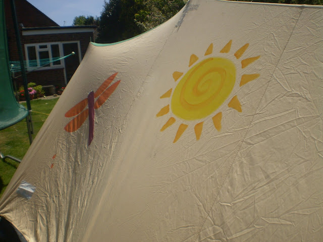 painting a canvas tent with fabric paints