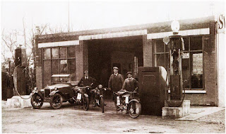 Jack Inwards in the centre outside his garage. J R Inwards forecourt