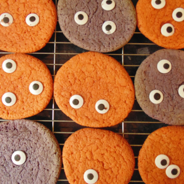 Orange and purple monster cookies with eyes