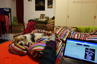 Art by Vasily Fedorouk on computer Dogsitting while writing an art newsletter