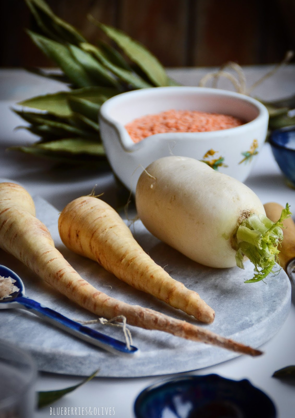 INGREDIENTS PARSNIPS, TURNIP, SALT FLAKES IN BLUE CERAMIC SPOON
